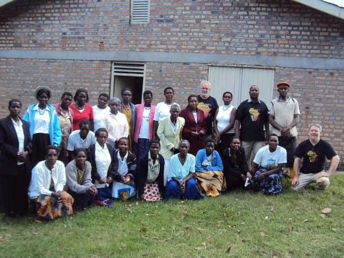 Lawrance tutors Alongisde African Uganda case workers in the use of Salesforce